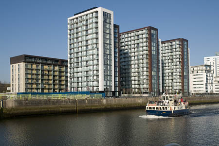 Sailing past Glasgow Harbour apartments