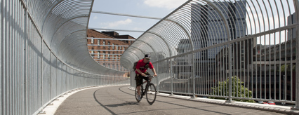 Cyclist on the completed bridge