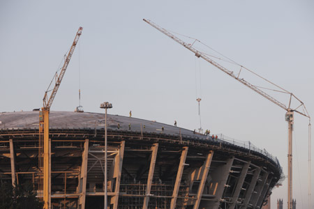 Construction workers on the roof of The SSE Hydro