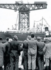 Titan in the background as by-standers view the launch of the Royal Yacht Britannia in April 1953